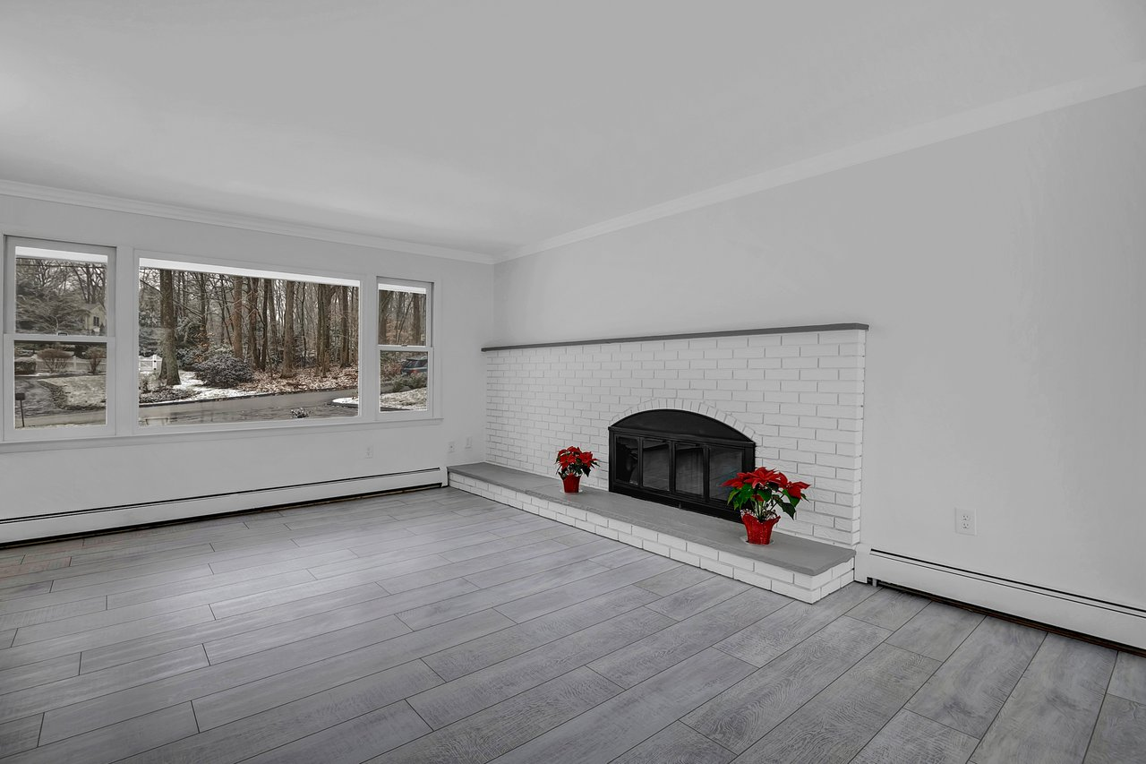 Beautiful fireplace is the focal point of the living room.
