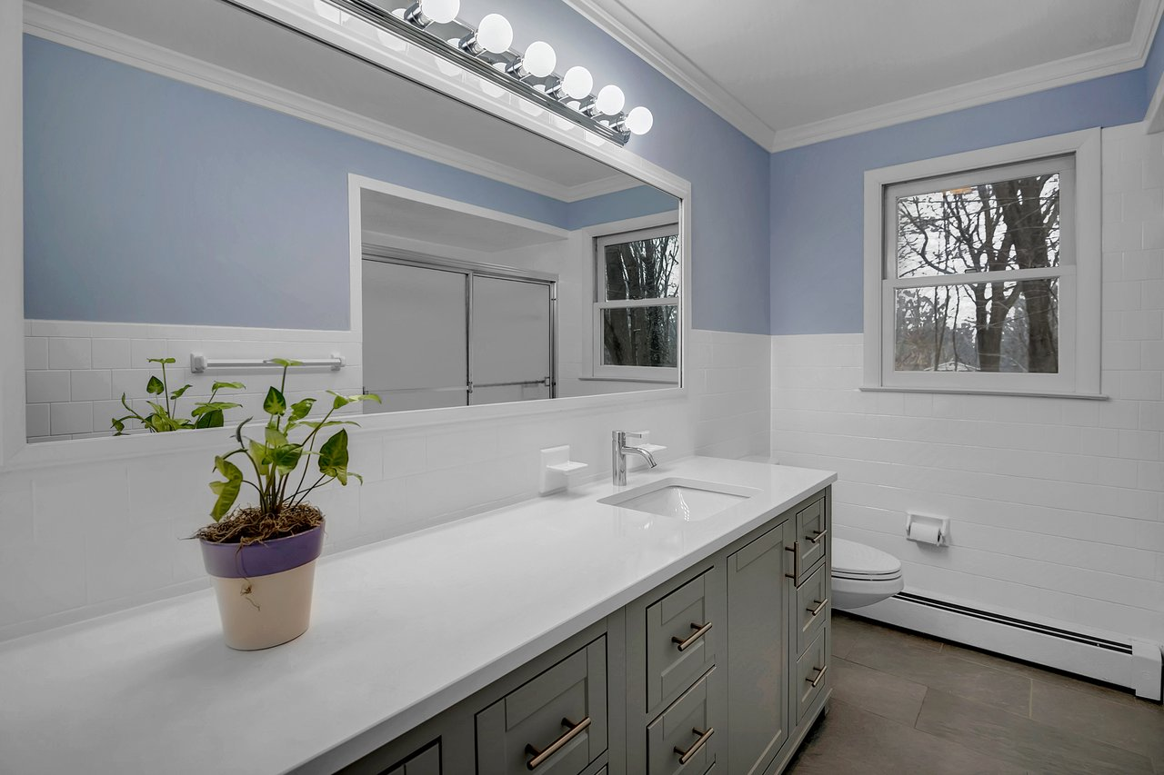 Full Bathroom features an extra long vanity