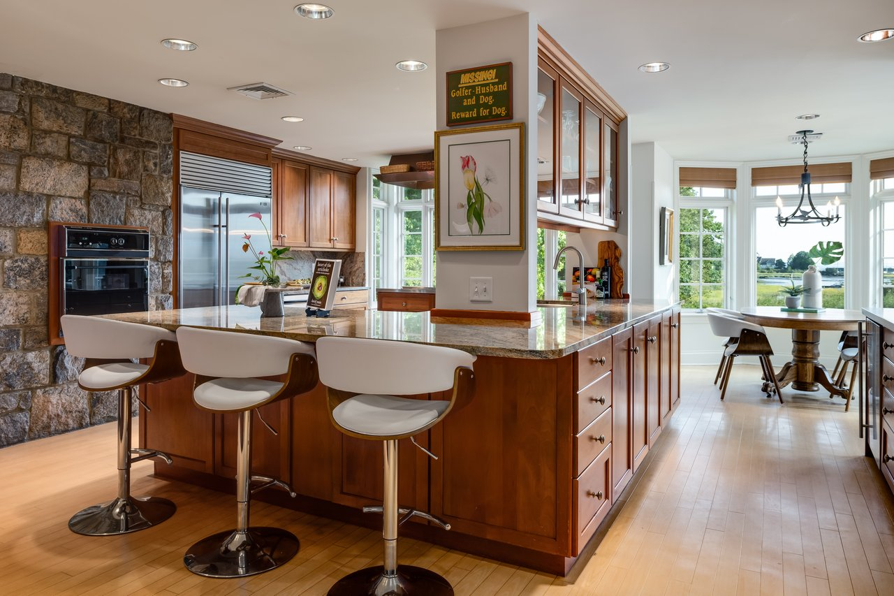 The main floor centers on the large, wonderful Chef's Kitchen with top-of-the-line appliances.