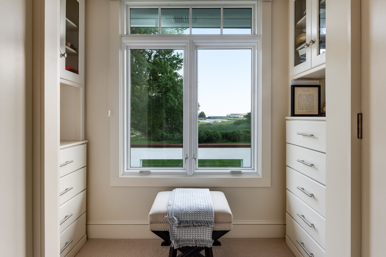 The Master Suite Dressing Room offers sweeping views of the property and marsh.
