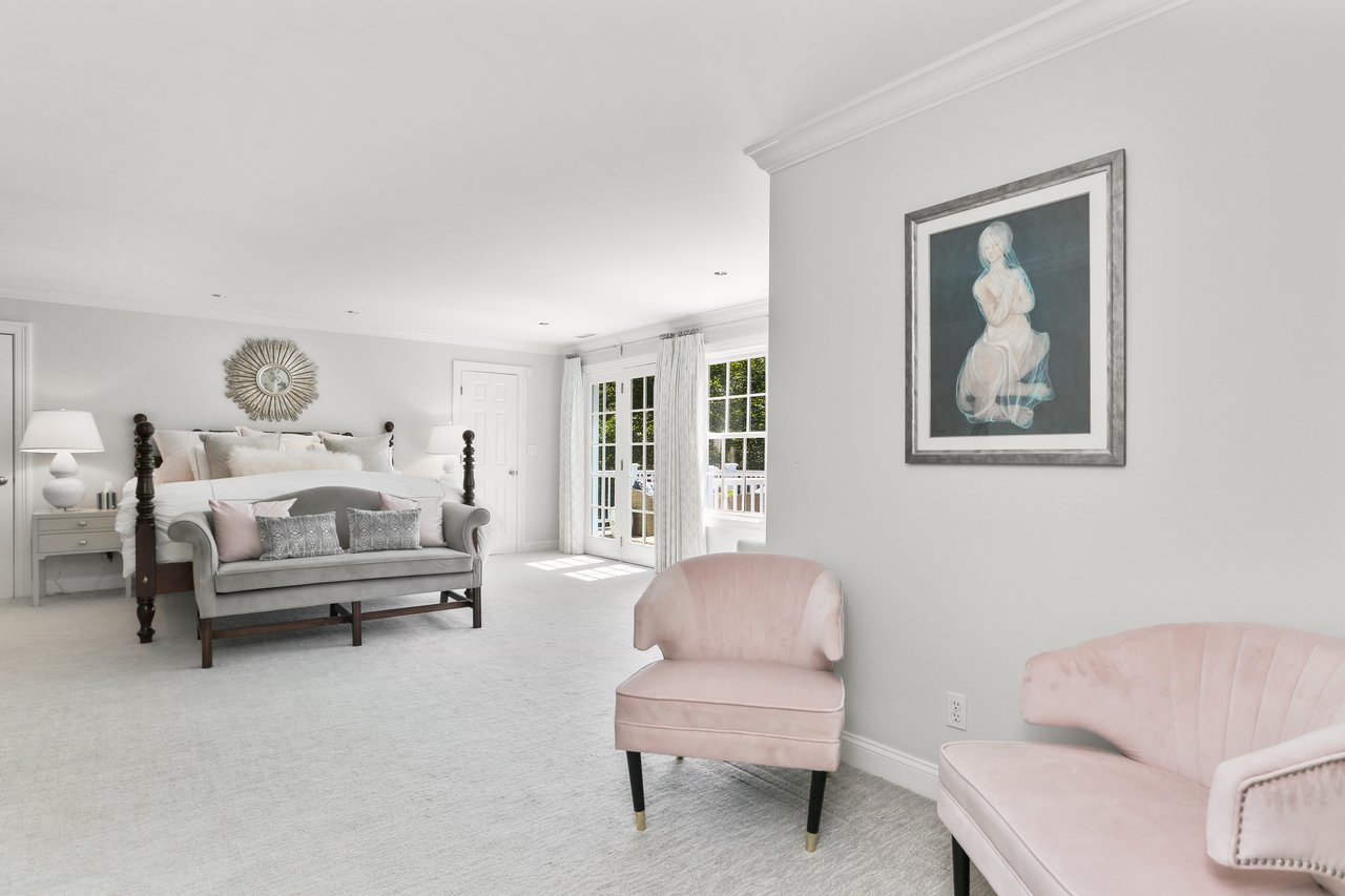 The Master Bedroom is complete with double walk-in closets, a full bathroom, and a private terrace.