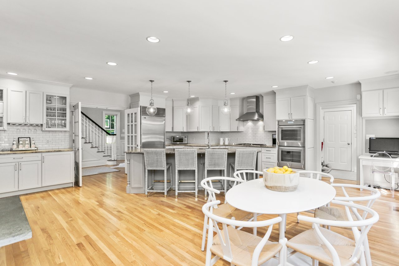 The spacious Kitchen offers a large center island, updated appliances, and plenty of storage space.