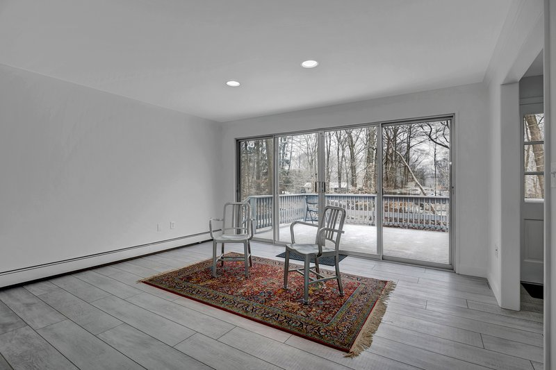 Double sliding doors allows for easy access to the deck.