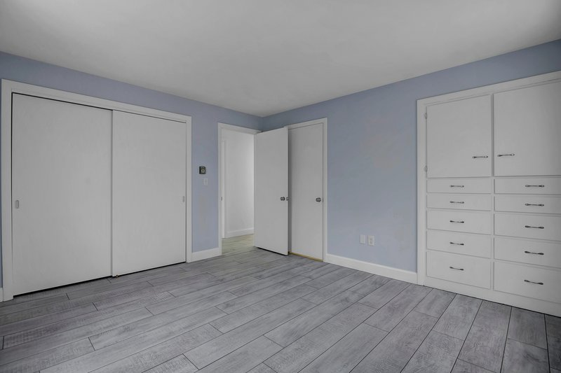 The first bedroom has a closet, built-ins, and a private full bathroom.