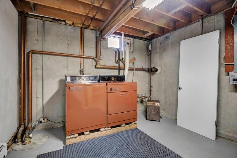 Oversized laundry room with storage.