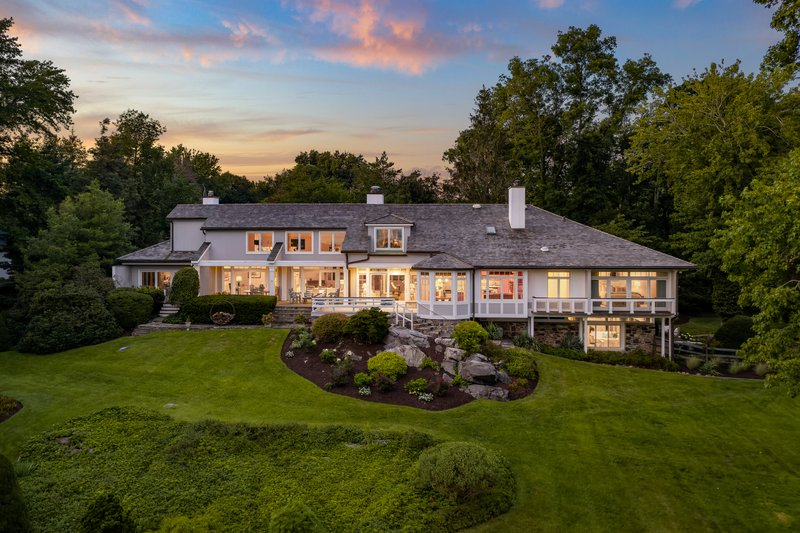 This architectural masterpiece is perfectly sited on 5+acres of magnificent landscape overlooking a bucolic, natural salt water estuary with direct access to Long Island Sound.