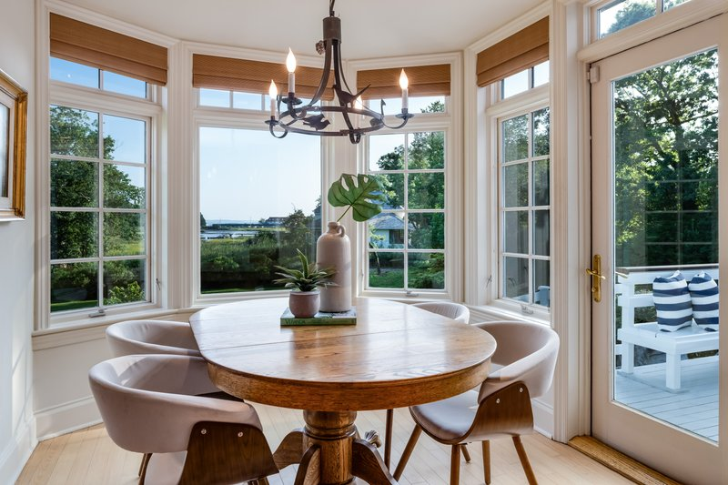 Beautiful full windows guarantee this kitchen wonderful natural light as well as outstanding views of both the property, water, and dock.