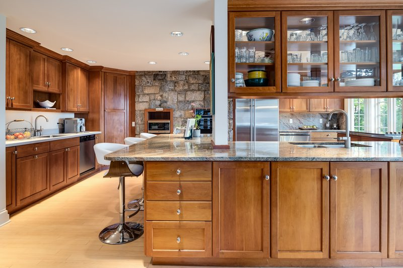 This kitchen includes two ovens, two dishwashers, a warming drawer, double sinks and a wonderful double-sided Viking cook-top.