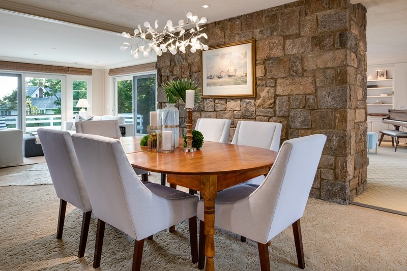 The dining room, family room, and living room all offer water views overlooking the Long Island Sound.