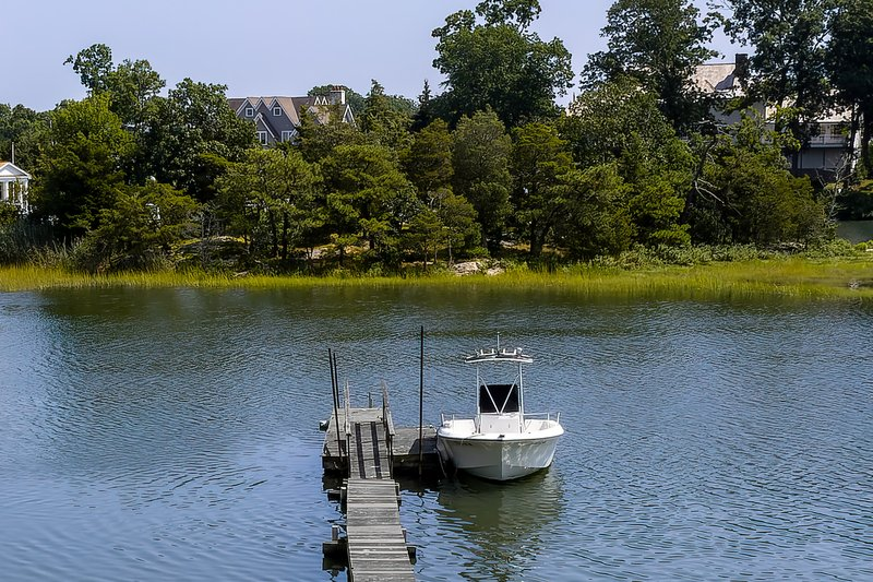 This property offers a shared dock with Long Island Sound access on either side of high tide.