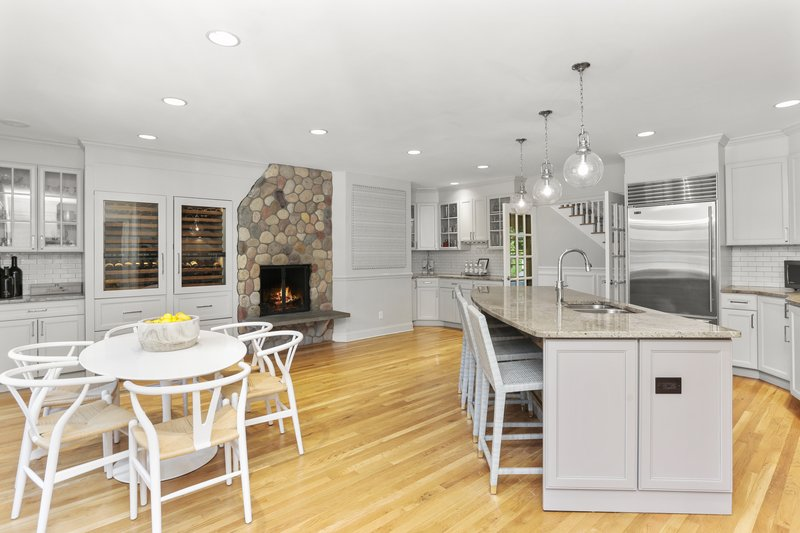The Chef's Kitchen is complete with top-of-the-line appliances, a large center island with plenty of counter seating, a spacious dining area, charming wood burning fireplace and fabulous views.