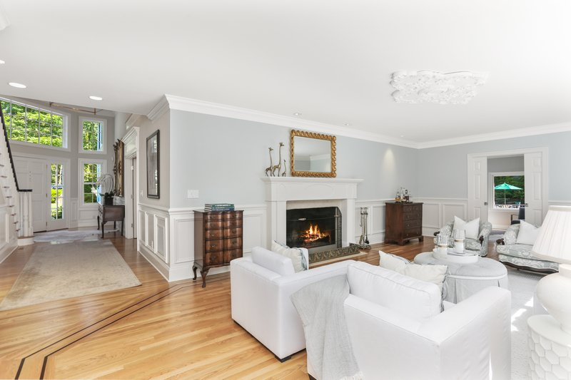 A lovely Living Room with a gorgeous fireplace offers plenty of great usable space for daily life and entertaining.