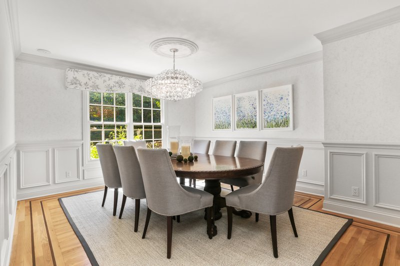 This dining space is perfect for intimate gatherings or lively entertaining.