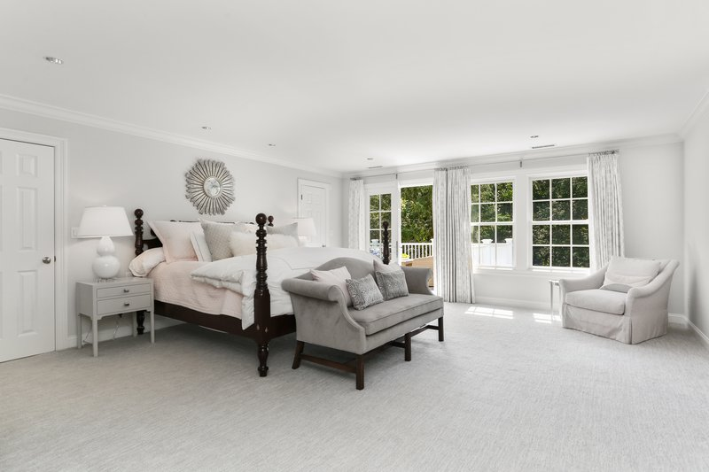 The Master Bedroom offers panoramic views of the backyard.