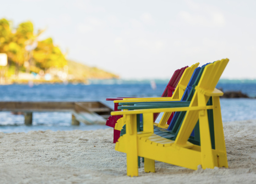 Colorful chairs on sand beach