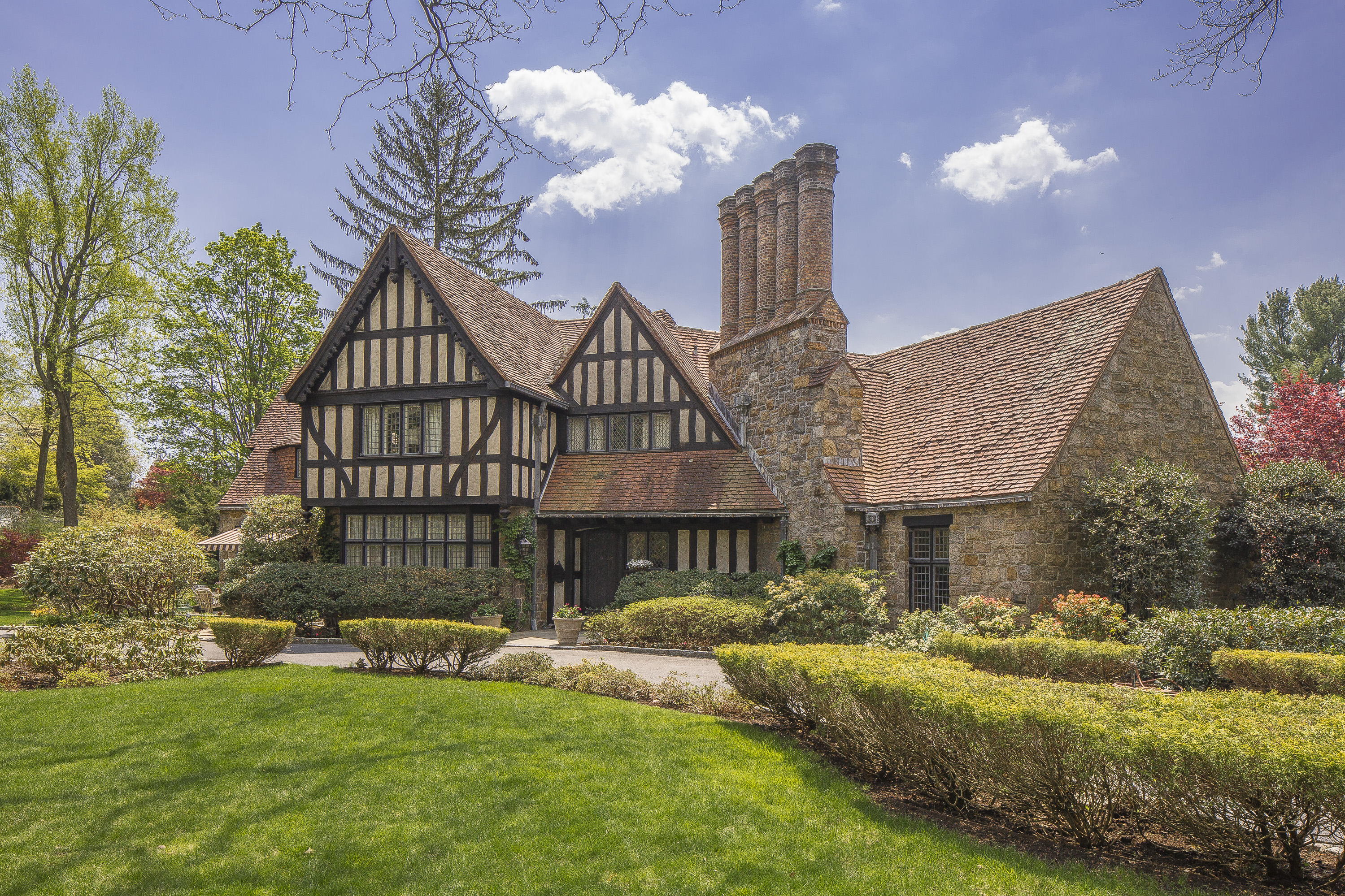 Keeping history alive a tudor revival masterpiece for Revival home