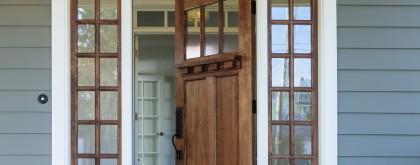 Exterior shot of an open Wooden Front Door