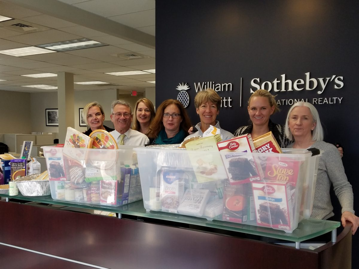 Members of the Ridgefield office with this year's donations.
