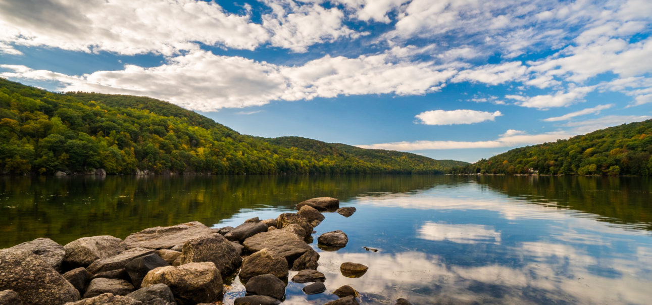Candlewood Lake in Connecticut with reflections and sky during fall