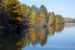 Colorful reflections of fall foliage on West Hartford reservoir.