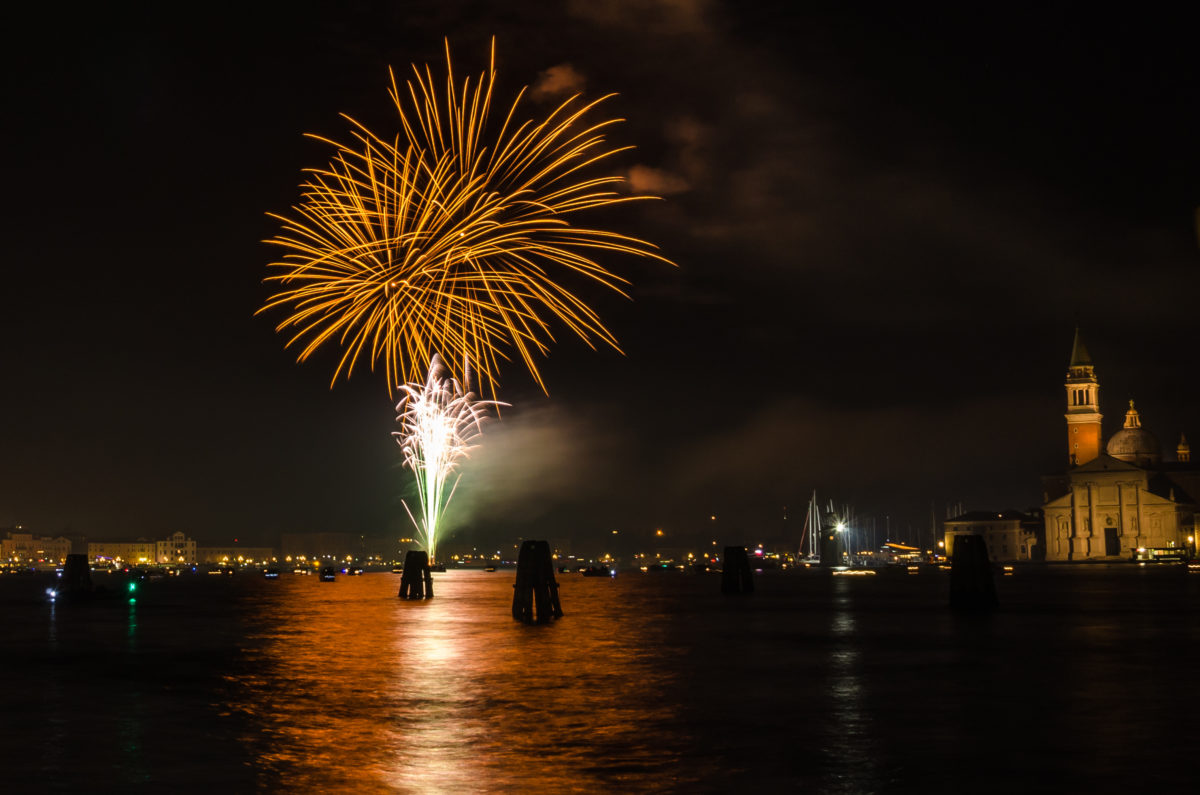 Beautiful Colourful Fireworks in Venice and Reflection in Water. St George Churchis visible on the right of the picture.