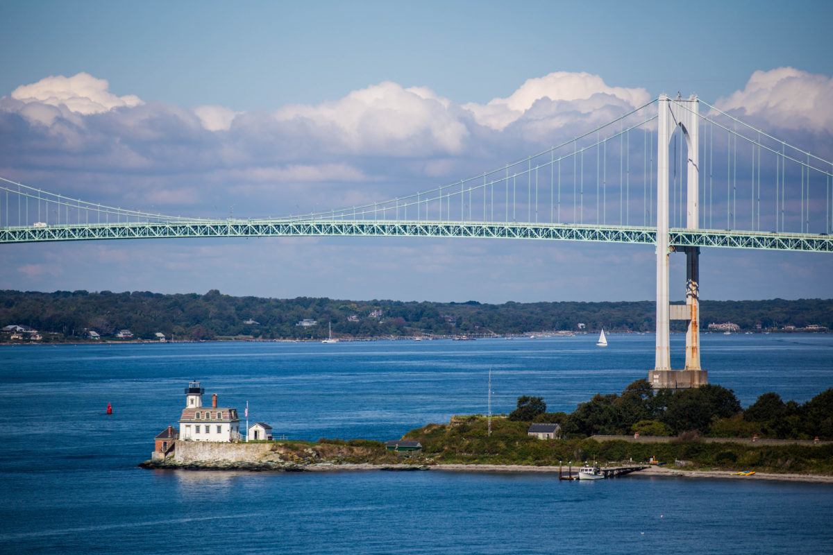 A view of the Rose Island Lighthouse and the Newport Bridge in Rhode Island.