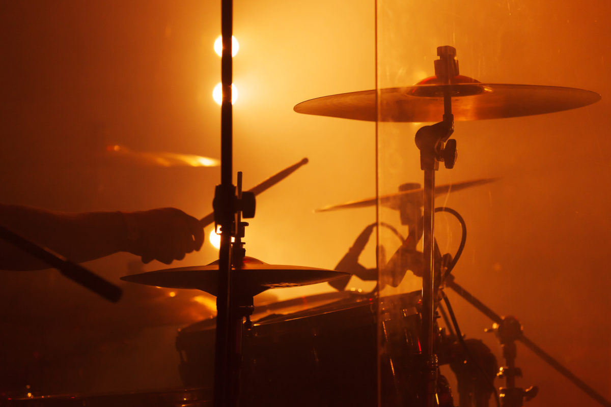 Live music background, drum set with cymbals and drummer hand