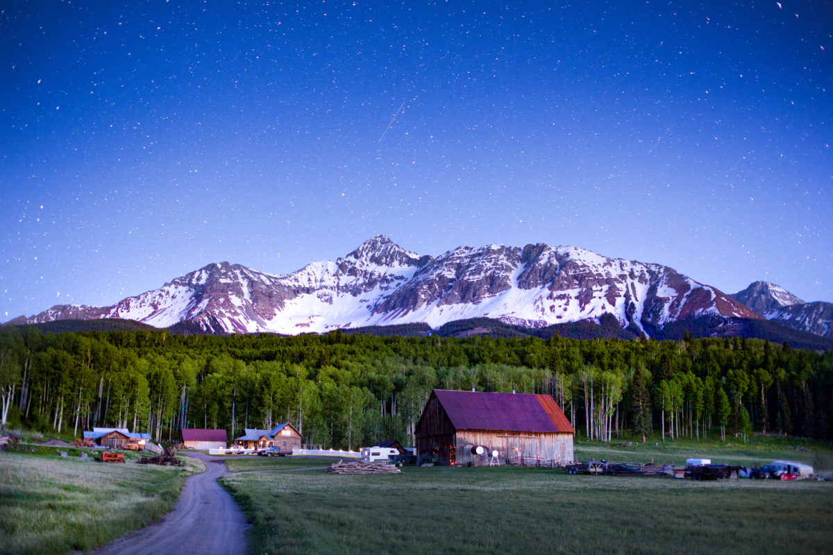 Ranch at the foot of Wilson Peak in southwest Colorado near Telluride at night with stars in the sky Creativecontentbrief 603439743