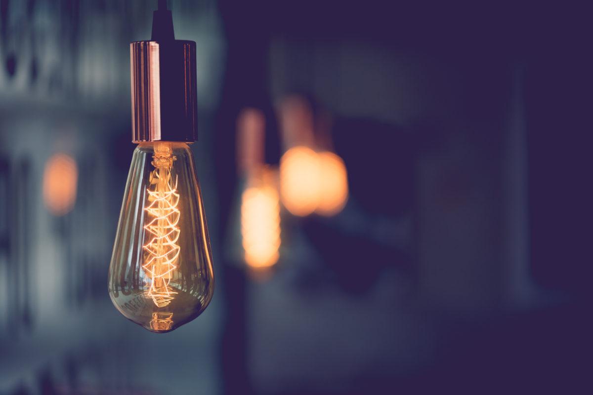 Vintage electric light.Decorative antique edison style light bulbs in coffee shop.vintage tone