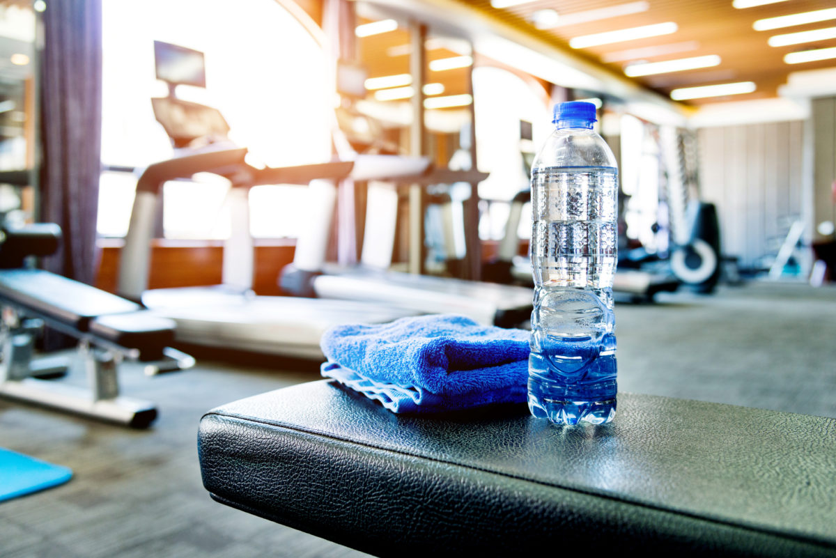 Towel and a bottle of water in gym
