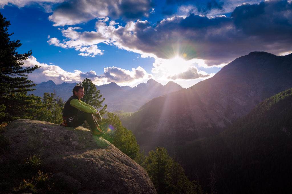 """Man at mountain sunriseSwiss National ParkMy images are processed from 16 bit RAW files in PROPHOTO colorspace,as possible to maintain the color fidelity when viewing on different devices and in the case of print for a correct and optimal conversion to CMYK"""