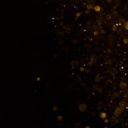 Golden glitter falling sparkle background on black border composition
