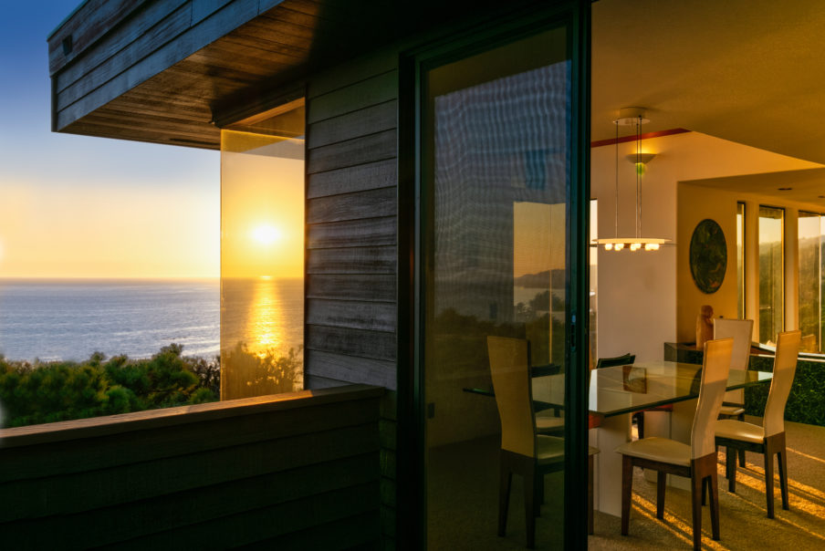 Architecture: house at sunset by ocean in California